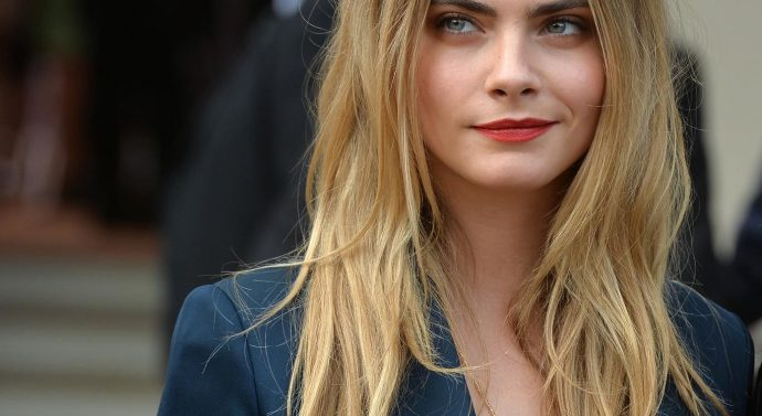 Cara Delevingne poses topless for advertisement