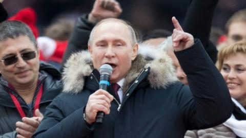 Russia goes to polls to give historic win for Putin